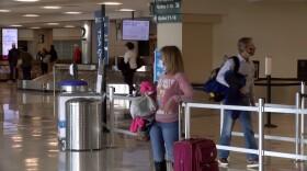 An airline passenger waits inside the San Diego International Airport, Nov. 25, 2020.