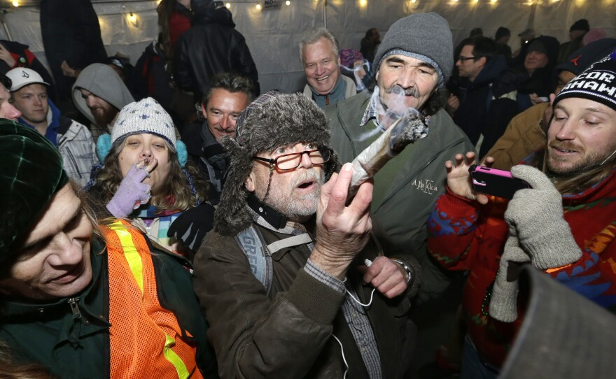 Partiers celebrate marijuana legalization in Washington state at a pot party in Seattle on Dec. 6.