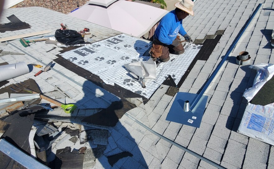 This undated photo shows Angelico Maldonado working on a roof before his death.