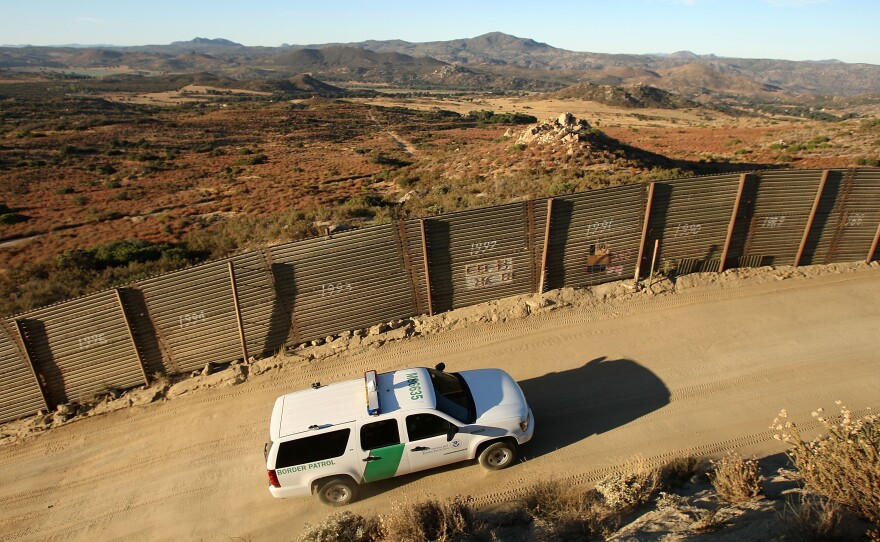 U.S. Border Patrol agents carry out special operations near the US-Mexico border fence near the rural town of Campo, some 60 miles east of San Diego, California, July 30, 2009.