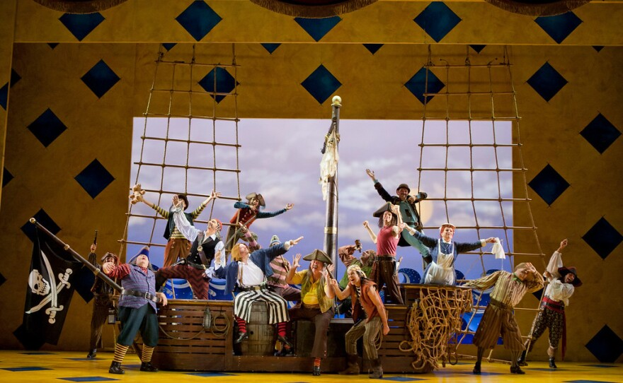 """Greer Grimsley (center) sings the role of The Pirate King in San Diego Opera's """"The Pirates of Penzance."""""""