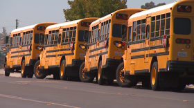 School buses are parked outside Woodrow Wilson Middle School in City Heights, Aug. 29, 2017.