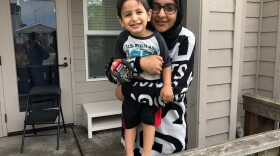 Sadia Kahn poses for a photo with her son Hashim outside their new apartment in University Village in this undated image.