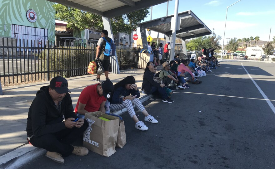 A group of people waiting to cross into Mexico through the PedWest pedestrian entrance, which was closed on November 25, 2018.