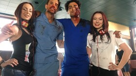 """Jen (left) and Sylvia (right) flank two of their actors on the set of """"Rabid."""""""