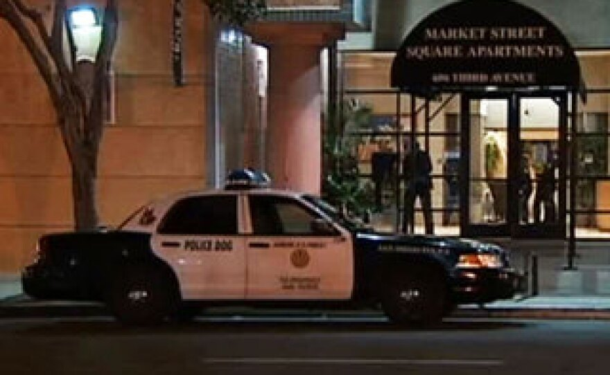 Officers went to a six-story residential complex just south of Horton Plaza Sunday, Oct. 14, 2012 after a report that a man wearing a tan military-style tactical vest and gas mask was walking around the building and grounds with a rifle in his hands.