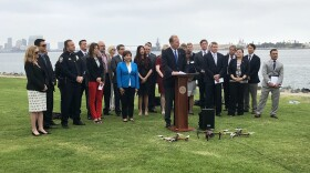 San Diego Mayor Kevin Faulconer is joined by Chula Vista Mayor Mary Salas and local business leaders at Harbor Island, May 10, 2018.