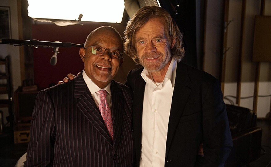 Henry Louis Gates, Jr. with William H. Macy on the set of FINDING YOUR ROOTS, Season 4.