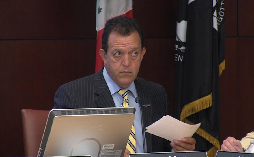 SANDAG Executive Director Gary Gallegos sits in a SANDAG board meeting, Aug. 4, 2017.