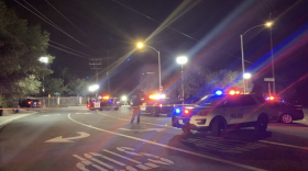 Authorities roping off the area of Bear Valley Parkway and Encino Drive following a fatal shooting involving an Escondido police officer and a suspect, Sept. 23, 2021.