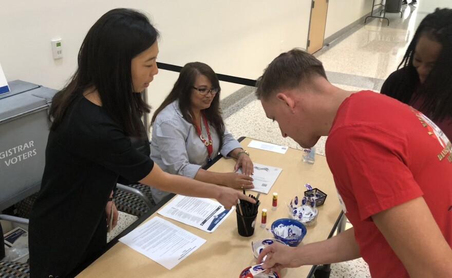 Voters turn in ballots at the San Diego County Registrar of Voters in Kearny Mesa, Nov. 5, 2018.