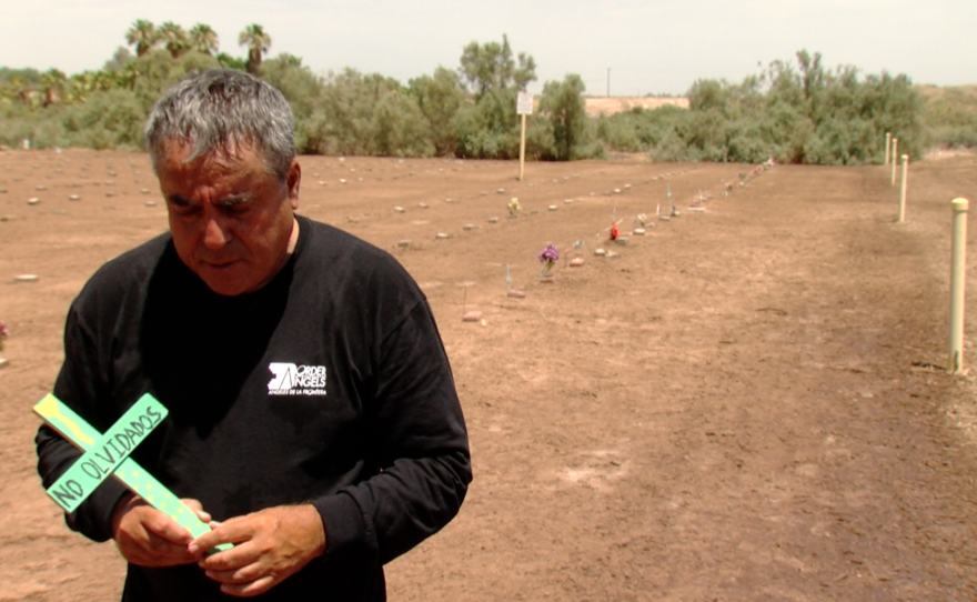 Enrique Morones, founder of Border Angels, stands in Terrace Park Cemetery, June 27, 2016.