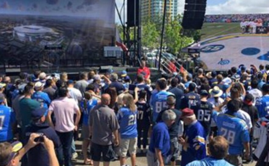 Hundreds turn out in downtown San Diego for a rally the Chargers hosted to kick off a drive to gather signatures for a November ballot measure to build the team a new stadium, April 23, 2016.
