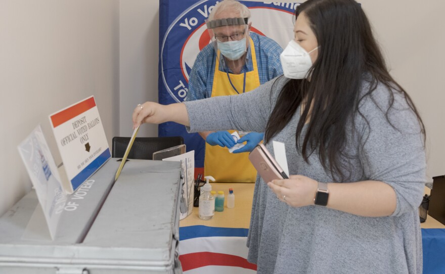 A voter casts her ballot during early voting at the San Diego County Of Registrars Office on Oct. 7, 2020.