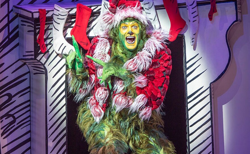 """Edward Watts as The Grinch in """"Dr. Seuss's How the Grinch Stole Christmas!,"""" book and lyrics by Timothy Mason, music by Mel Marvin, original production conceived and directed by Jack O'Brien, original choreography by John DeLuca, and directed by James Vásquez, 2019. Photo by Jim Cox."""