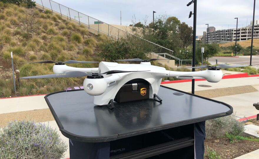 A Matternet company drone holds a UPS package before it takes off in a UC San Diego Health demonstration, February 28, 2020.