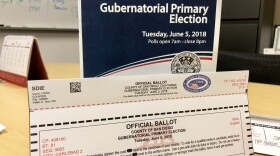 The 2018 gubernatorial primary election sample ballot and official ballot are pictured on a table, May 4, 2018.