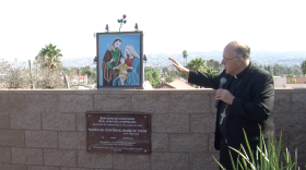 Bishop Robert McElroy consecrates a memorial wall at Our Lady of Mount Carmel Catholic Church in San Ysidro, September 20, 2015.
