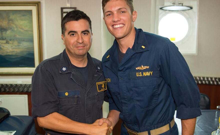 Cmdr. Luis Alva and crew member aboard the USS Vandegrift (FFG 48), September 2014.