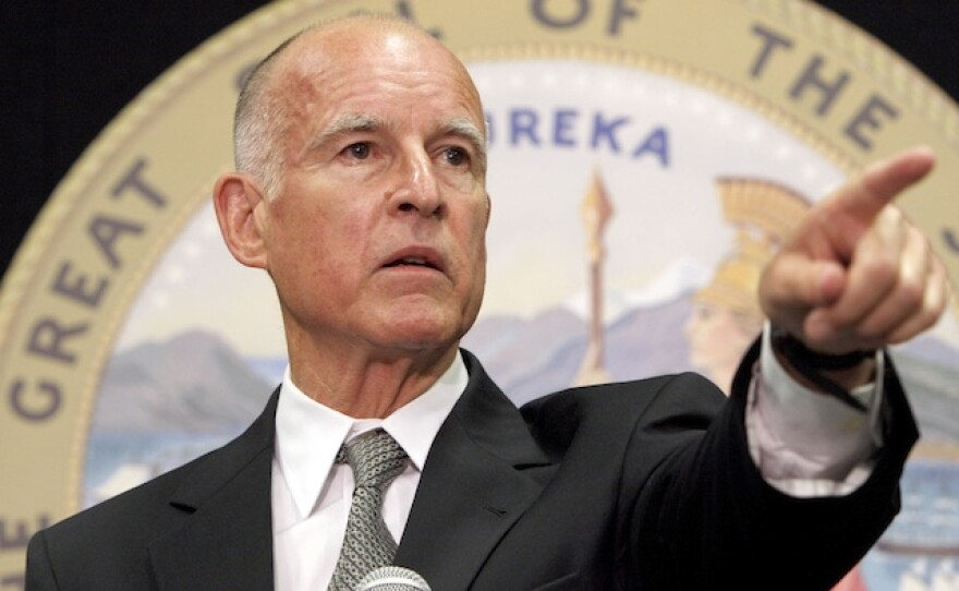 Gov. Jerry Brown talks to reporters at the state capitol, April 29, 2014.