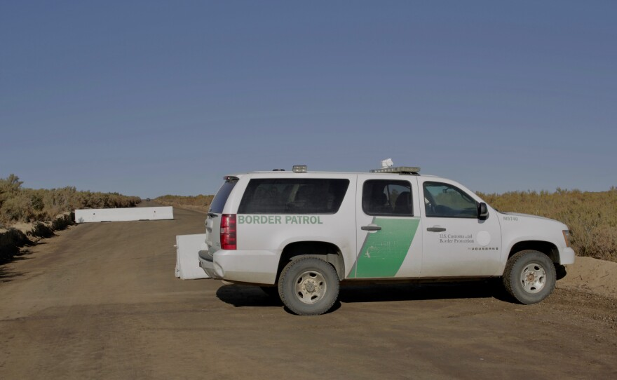 A Border Patrol vehicle blocks a road leading to the construction site for the border wall east of Campo on Sept. 22, 2020.