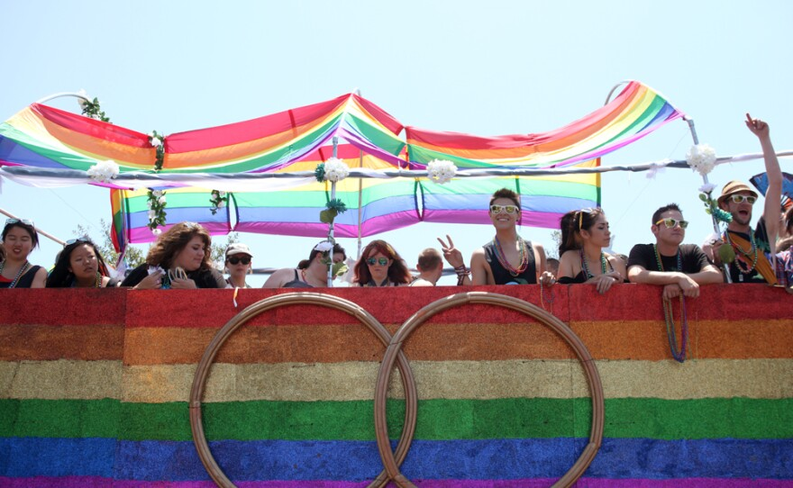 A float carrying participants in the San Diego Pride Parade waits its turn on Normal Street, July 13, 2013.
