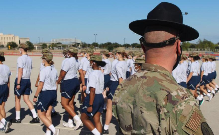 Trainees march in formation at Joint Base San Antonio-Lackland in this undated photo. The Air Force has restructured basic military training so that there is less travel time and fewer opportunities to practice drill.