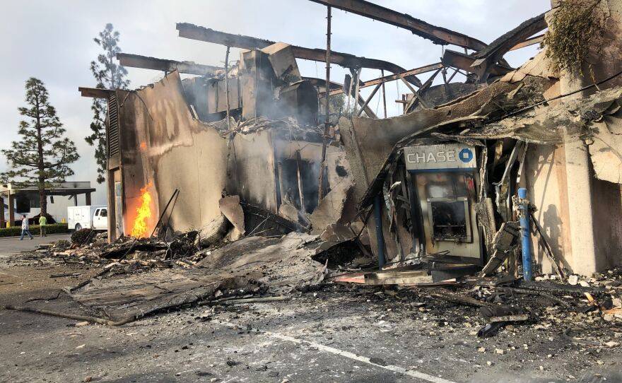 Small flames still burn at Chase bank location on Spring Street in La Mesa the morning after destructive protests, May 31, 2020.