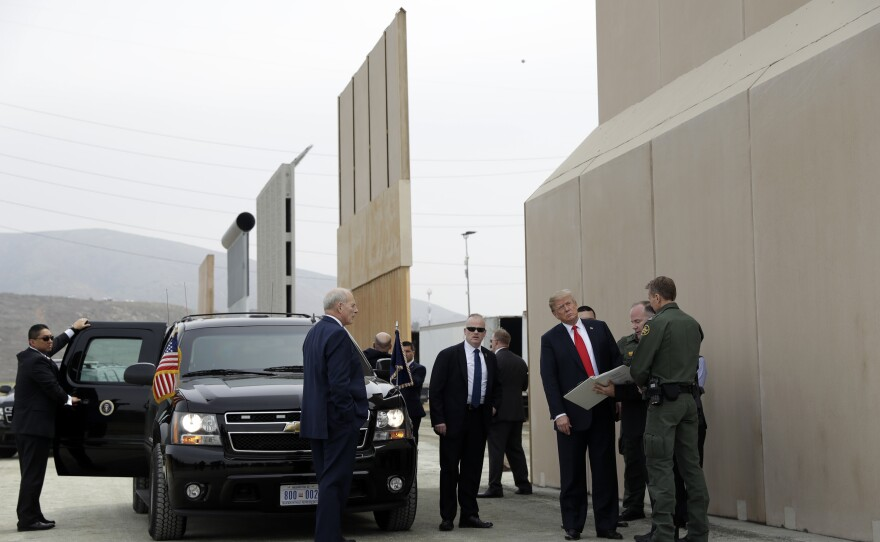 President Donald Trump reviews border wall prototypes in San Diego, Ca., Tuesday, March 13, 2018.