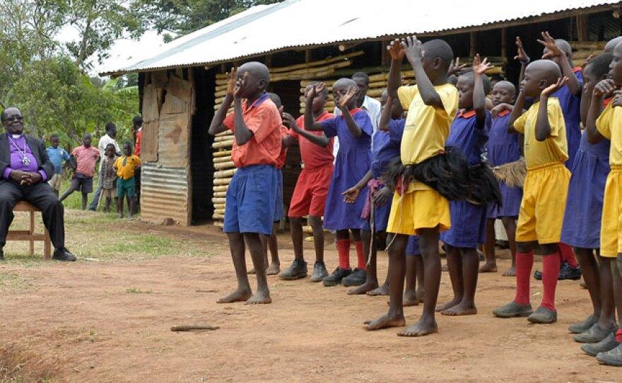 Bishop Christopher Senyonjo visiting a rural school in Uganda.
