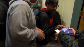 A Logan Elementary School student picks up an anti-bullying pamphlet, Feb. 2, 2017.