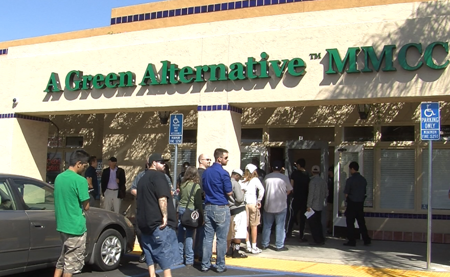 People line up in front of A Green Alternative in Otay Mesa on the day of its grand opening, March 20, 2015.