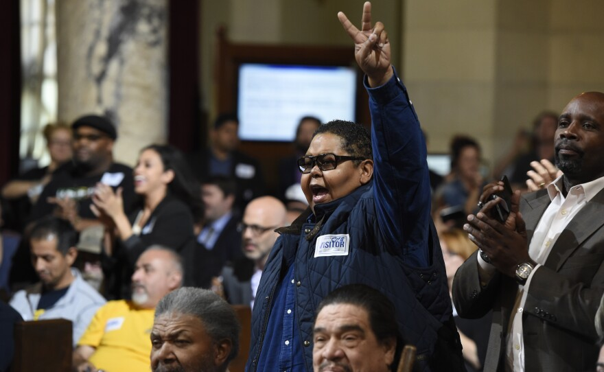 Donnie Anderson, co-founder and chairman of the California Minority Alliance, reacts after the Los Angeles City Council voted unanimously to approve new regulations for the marijuana industry on in Los Angeles. Wednesday, Dec. 6, 2017.