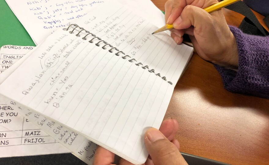 Mirtha Ninayahuar writes notes during a Mam language class at Laney College in Oakland, April 13, 2019. Ninayahuar volunteers at a Sunday school where most of the children speak only Mam.