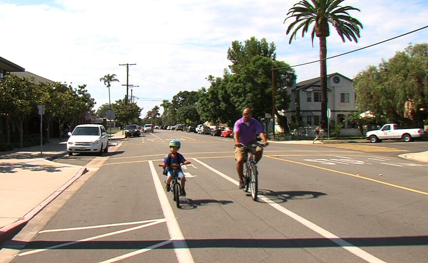 A father and son ride down a bike lane next to Coronado's elementary school, Sept. 22, 2015.
