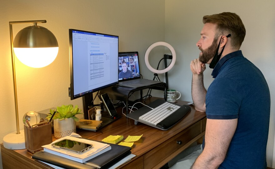 Andrew Picard looks at his computer during a virtual meeting with a colleague while working from home, March 3, 2021.