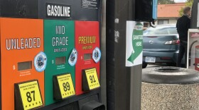 A man fills up his car with gasoline at a 7-11 gas station in Encinitas, Mar. 13, 2021.