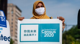 A census supporter holds up a sign during a 2020 rally in  New York City.