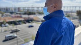 Victoriano Diaz, senior associate director of patient engagement  and special events at Family Health Centers of San Diego, stands on the roof of the Logan Heights clinic overlooking the parking lot his team will transform into a vaccination site, Feb. 4, 2021.