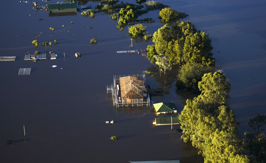 Buildings are partially submerged as floodwater covers large areas of northwest of Sydney on Wednesday.