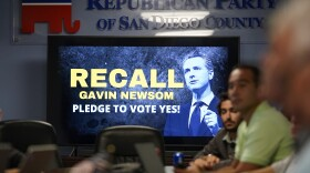 People listen during a meeting of volunteers to get out the vote by supporters of the effort to recall California Gov. Gavin Newsom at the San Diego Republican Party Headquarters, Monday, Sept. 13, 2021, in San Diego.