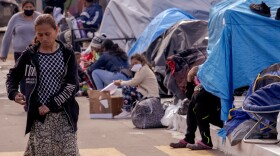Hundreds of asylum-seekers are camping out at the El Capparal plaza on Mexican side of the San Ysidro Port of Entry, March 12, 2021.