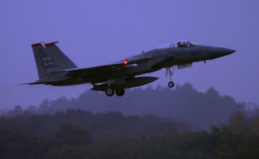 An F-15 Eagle from the 67th Fighter Squadron at Kadena Air Base, Japan, takes off for a mission, November 2012.