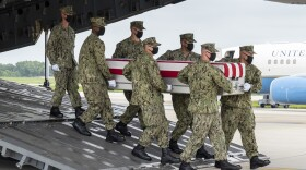 A U.S. Navy carry team transfers the remains of Navy Hospitalman Maxton W. Soviak of Berlin Heights, Ohio, Aug. 29, 2021, at Dover Air Force Base, Delaware.