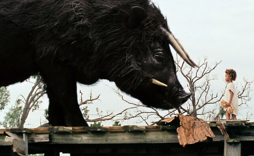 """Quvenzhané Wallis as Hushpuppy facing down the """"Beasts of the Southern Wild."""""""