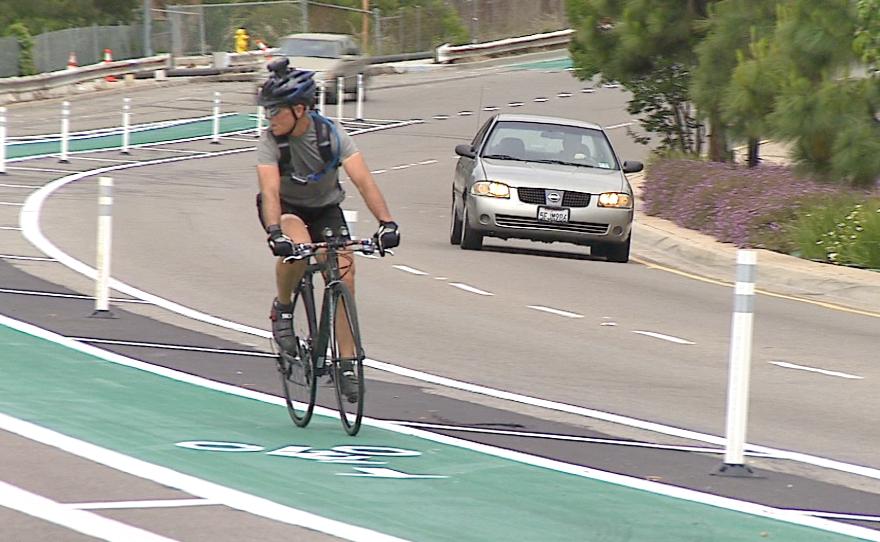 A cyclist rides in a new bike lane.