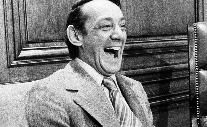 In this April 1977 file photo, San Francisco supervisor Harvey Milk sits in the mayor's office during the signing of the city's gay rights bill in San Francisco.