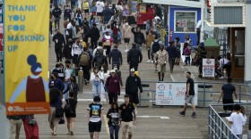 In this Thursday, May 13, 2021, file photo, a posted sign thanks visitors for wearing masks in Santa Monica, Calif.