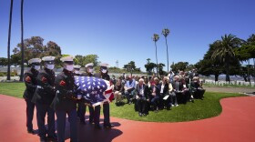 A military honor guard escorts the casket of Marine Corps Pfc. John Franklin Middleswart for full military honors at Fort Rosecrans National Cemetery on Tuesday, June 8, 2021, in San Diego.