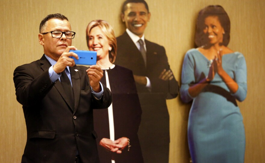 Juan Bermudez takes a selfie with cardboard cutouts of Democratic presidential candidate Hillary Clinton, President Barack Obama and First Lady Michelle Obama at the Westin Gaslamp Hotel, Nov. 8, 2016.